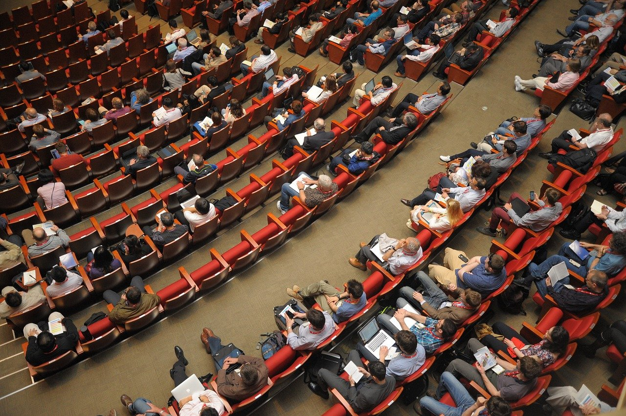 Overhead view of students seated in a lecture hall.